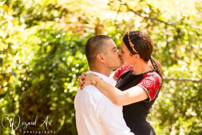 Couple kissing in nature at Sydney Botanic Gardens.