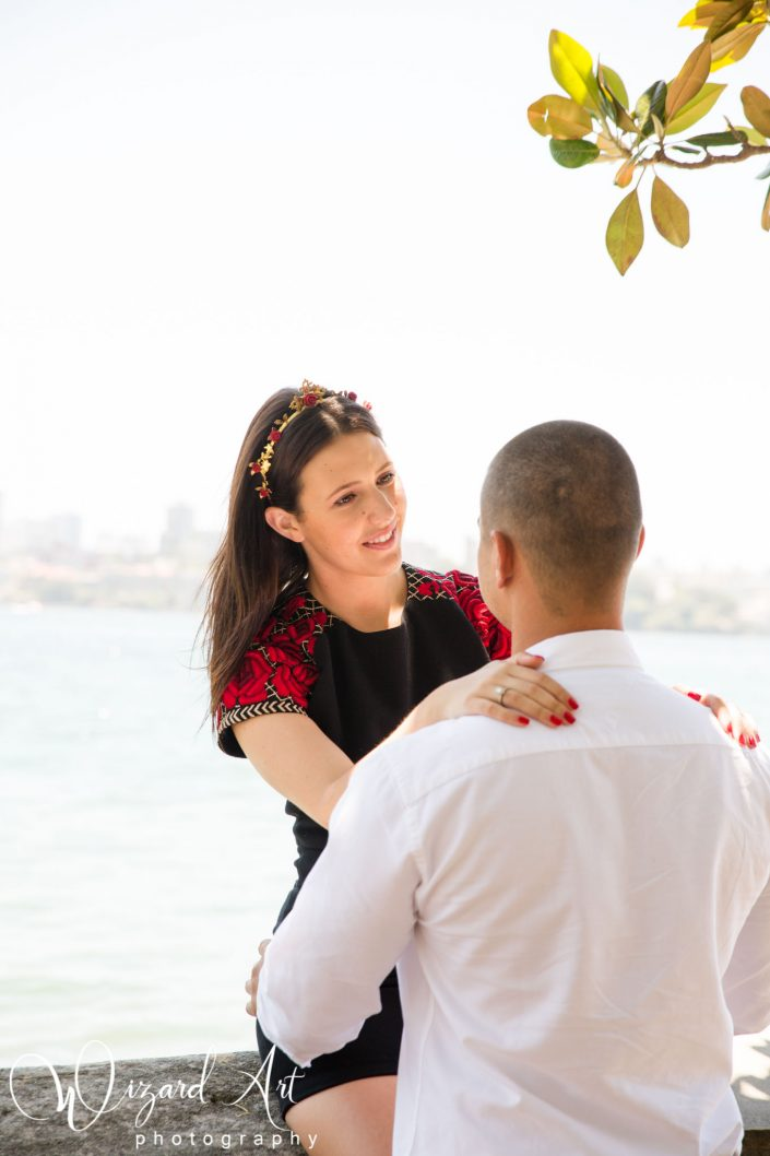 Girl looking lovingly at her partner at Sydney Harbour.