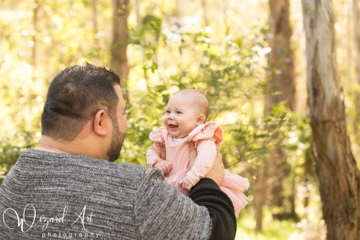 Happy baby girl smiling at daddy