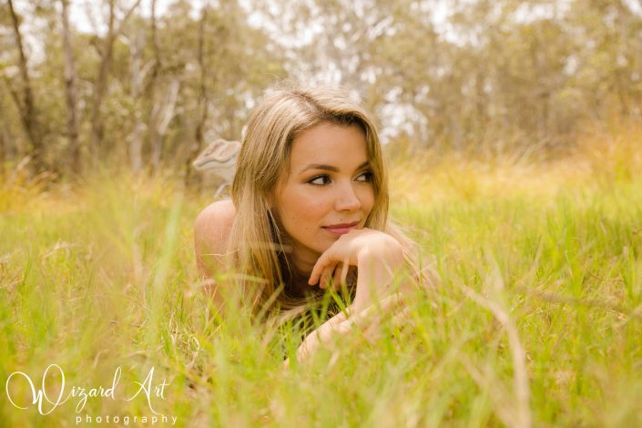 Woman laying in long grass at Nurragingy Reserve, Doonside.