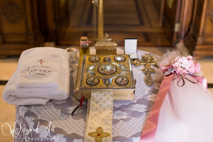 Serbian Orthodox christening table setup during church ceremony.