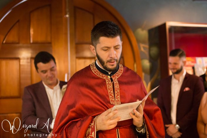 Serbian Orthodox priest conducting christening ceremony at St Stefan Serbian Orthodox Church in Rooty Hill, Sydney.